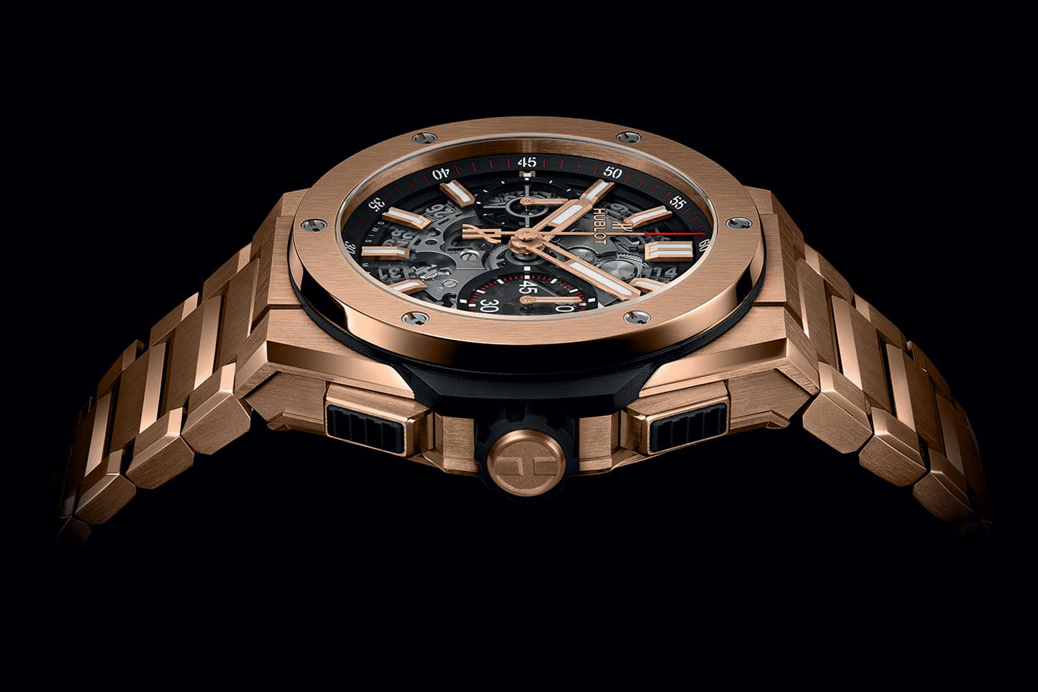 The Hublot Big Bang Unico Bracelet King Gold from the side, revealing the original pushers of the Big Bang which inspired the integrated bracelet's construction.