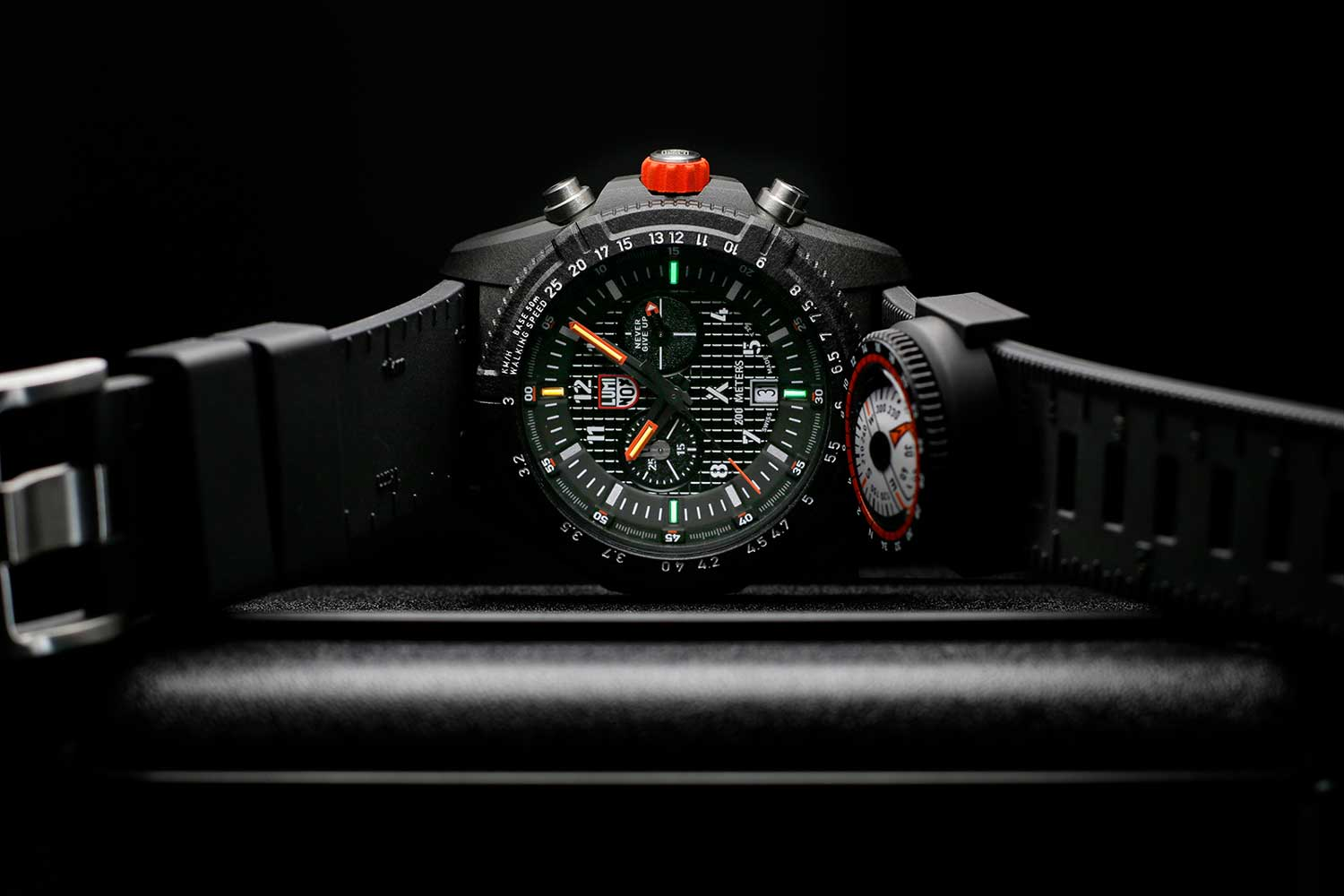 The Luminox Bear Grylls Survival 3780 Land Series in CARBONOX, with a compass attachment and rubber strap with ruler and Morse code markings.