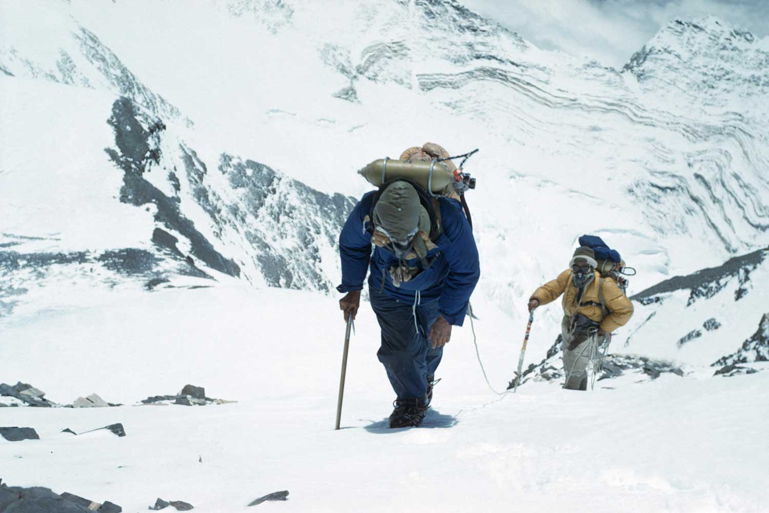 Sir Edmund Hillary and Sherpa Tenzing Norgay ascending Mt. Everest as part of Sir John Hunt's team