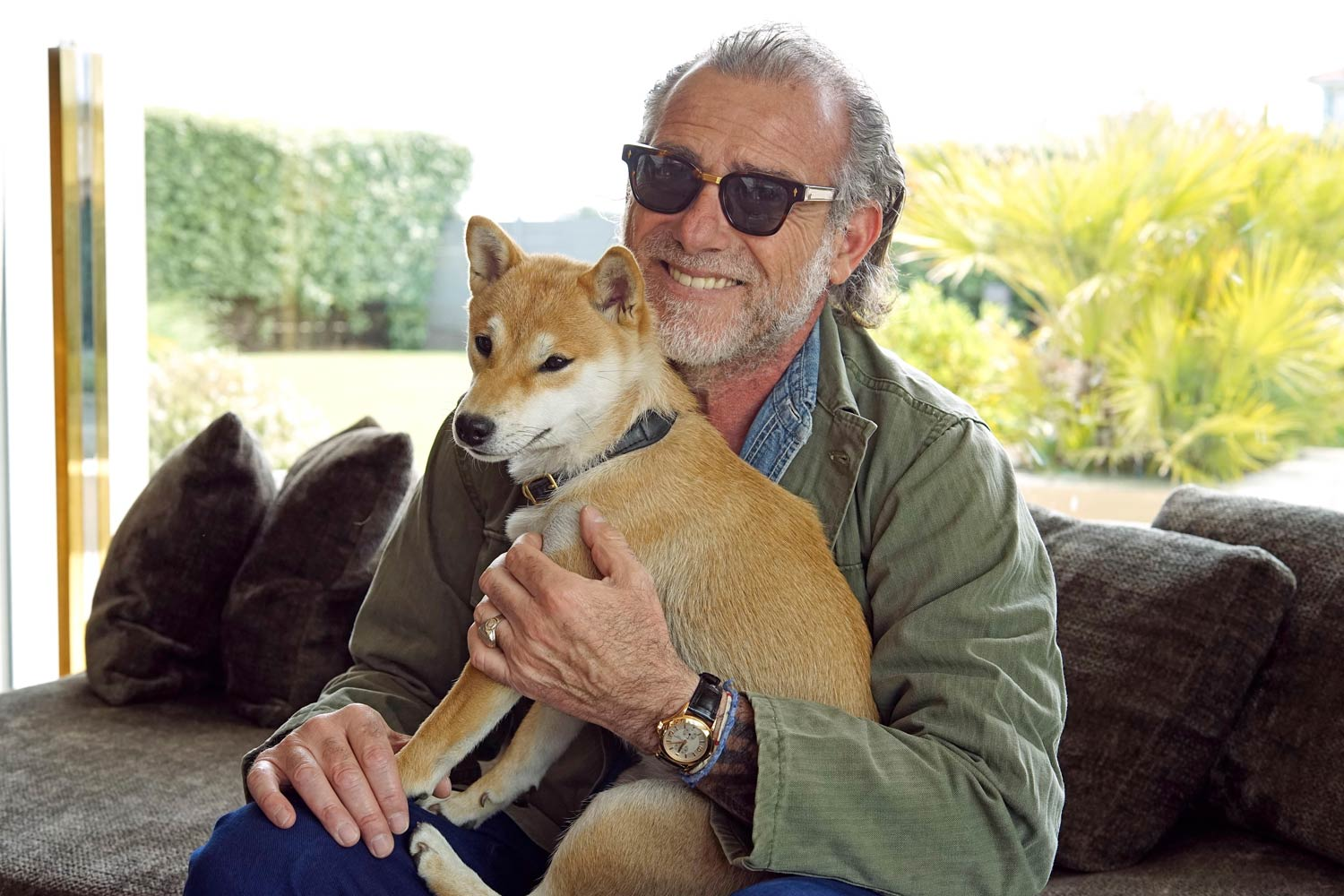 Alessandro with his Japanese Shiba Inu dog, wearing a pink gold Patek Philippe Travel Time, ref. 5134 with cal. 215 PS FUS