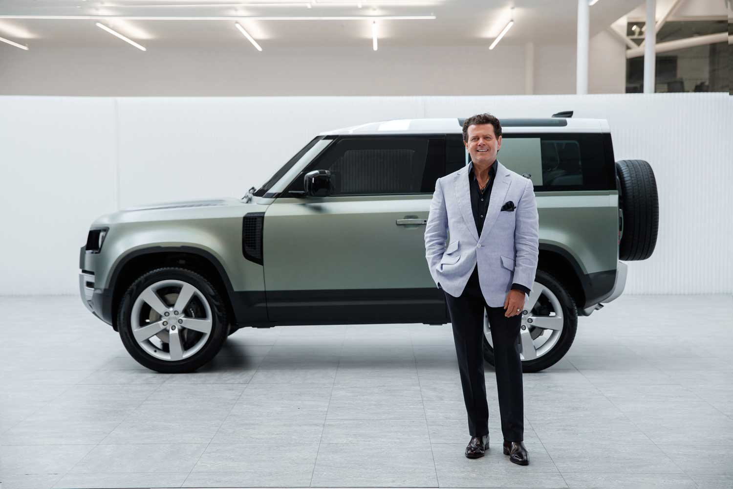 Gerry McGovern, Land Rover's creative director in front of the 2019 Defender