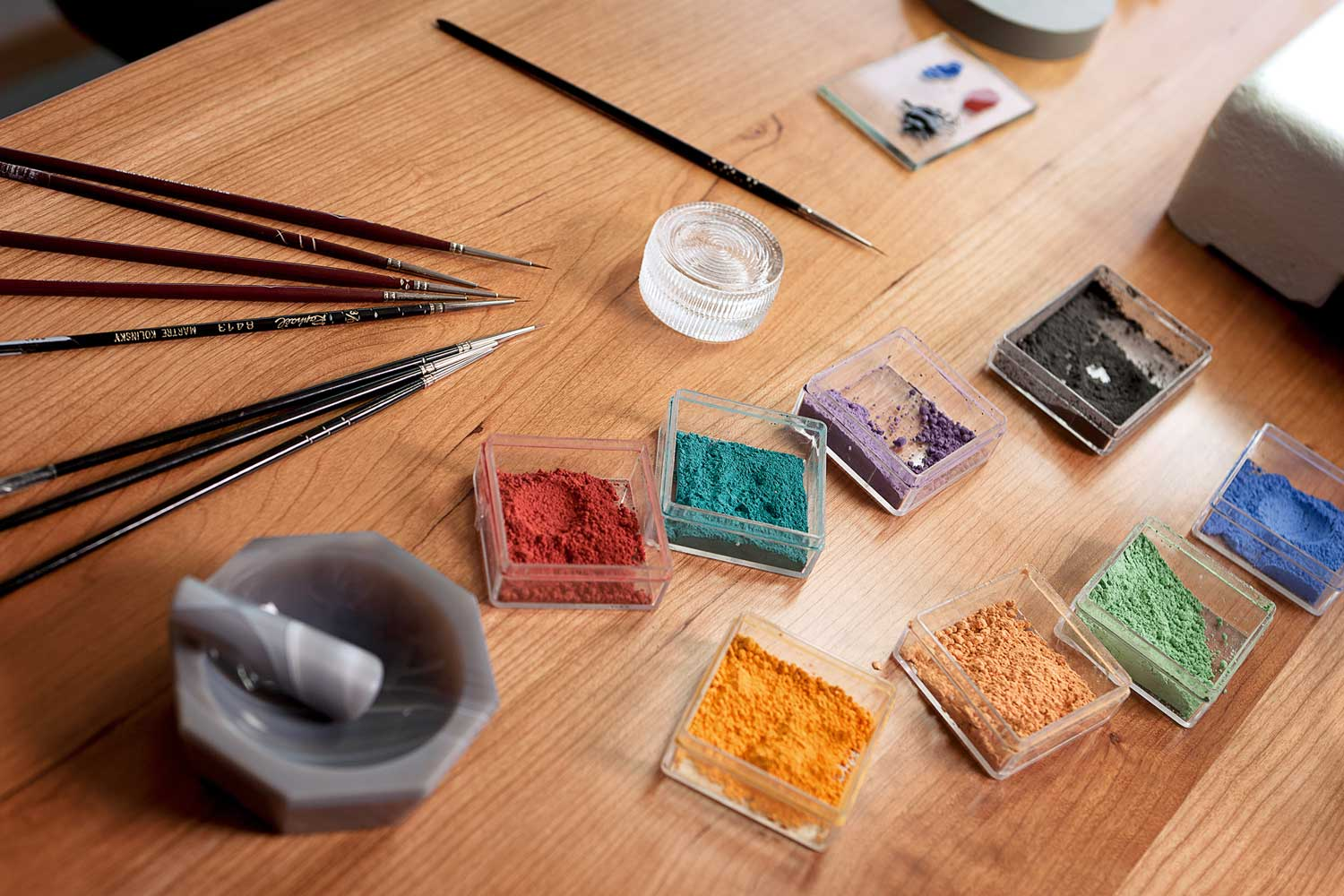 Blancpain's enamellers create their colours by mixing fine enamel powder with metallic oxides and pine oil, before painting with microscopically fine brushes.