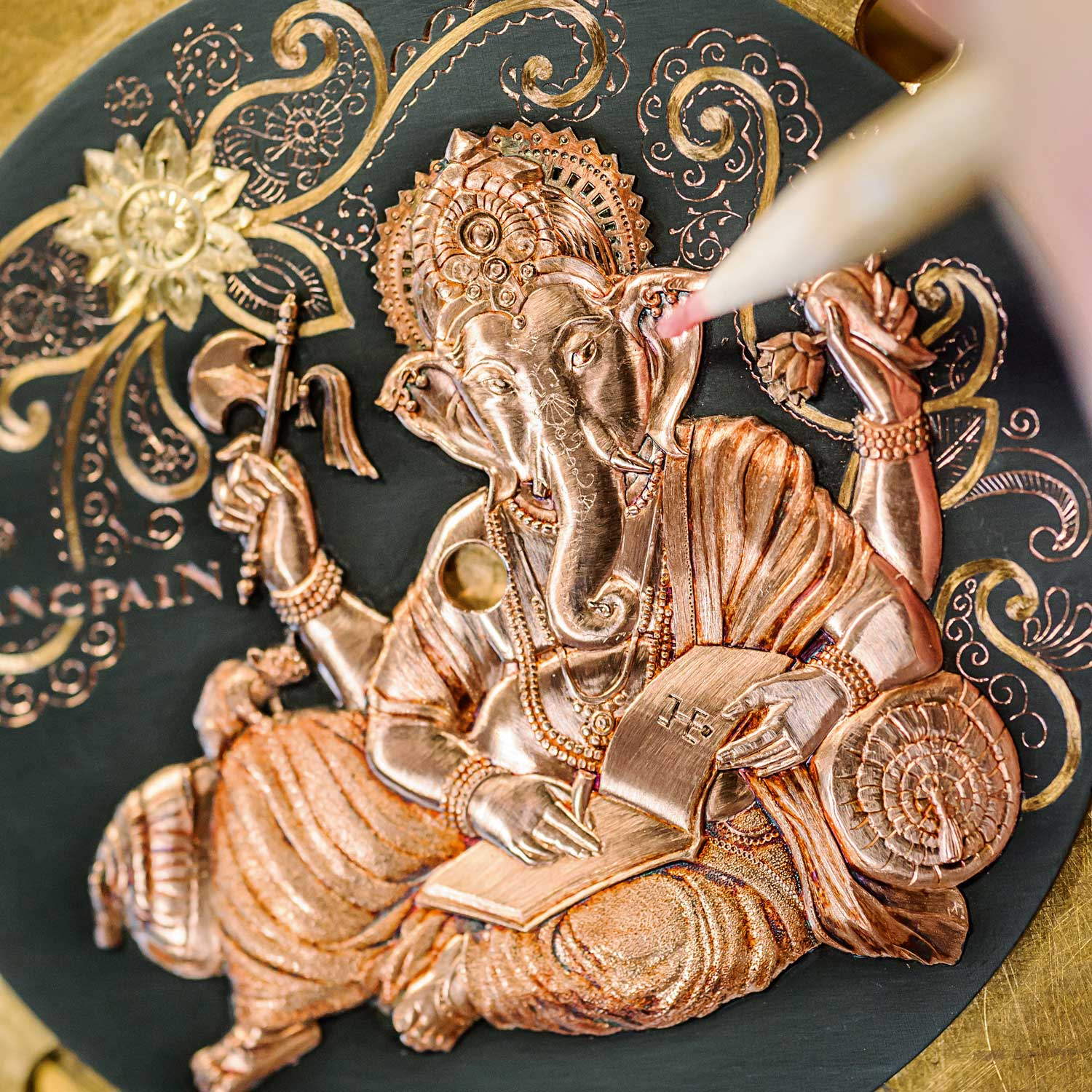The creation of the award-winning Villeret Shakudo Ganesh begins with drawings of the Hindu god, before engraving the divinity and decorative motifs on the dial.