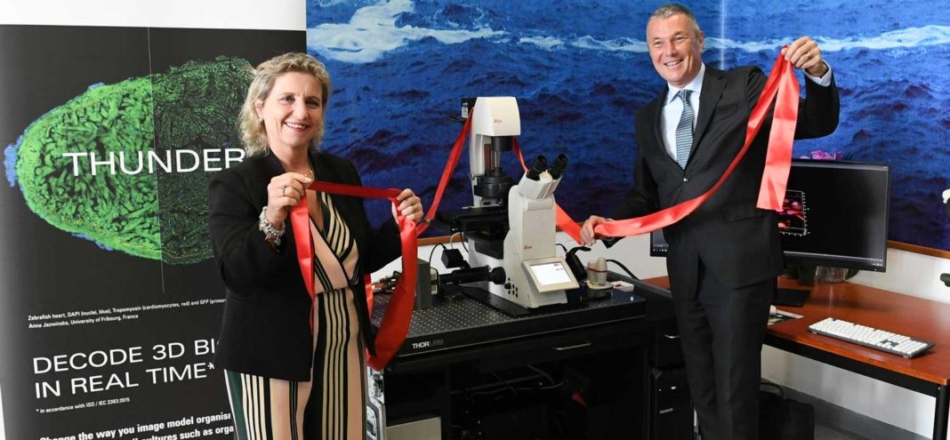 Marta Branca, General Manager of Spallanzani unveiling the recently acquired 3D microscope with Bulgari CEO, Jean-Christophe Babin , which is meant to help speed up the development of a vaccine against COVID-19 at the Rome based institute
