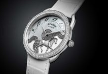 The Hermès Arceau Cheval Cosmique in mother-of-pearl and enamel dial.