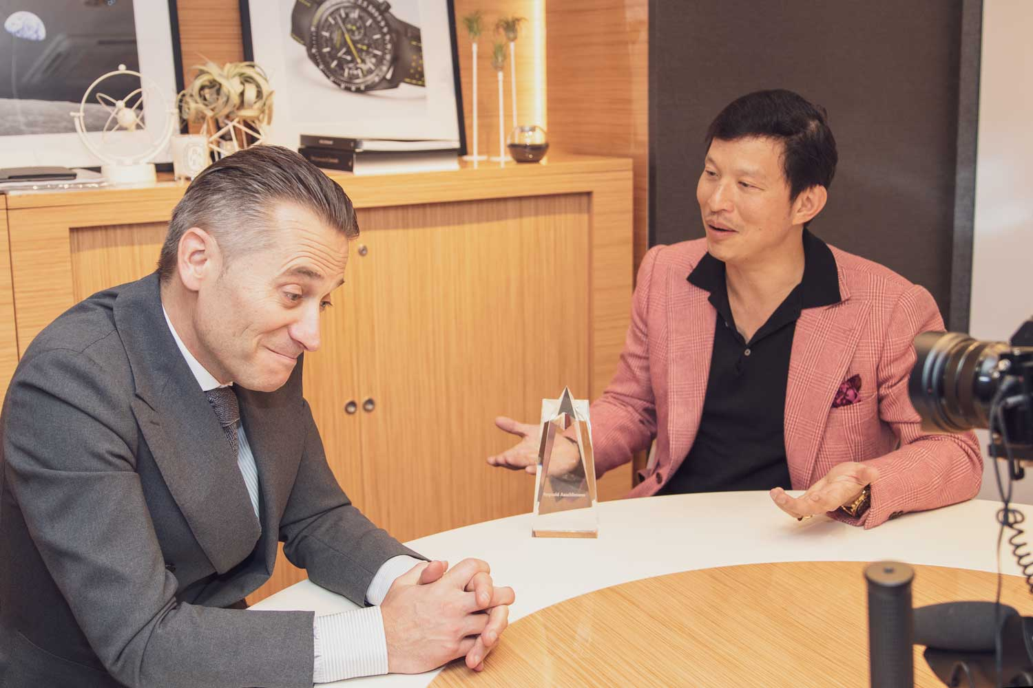 Wei with Raynald Aeschlimann, CEO of Omega at the brand's booth at Baselworld 2018 (Image © Revolution)