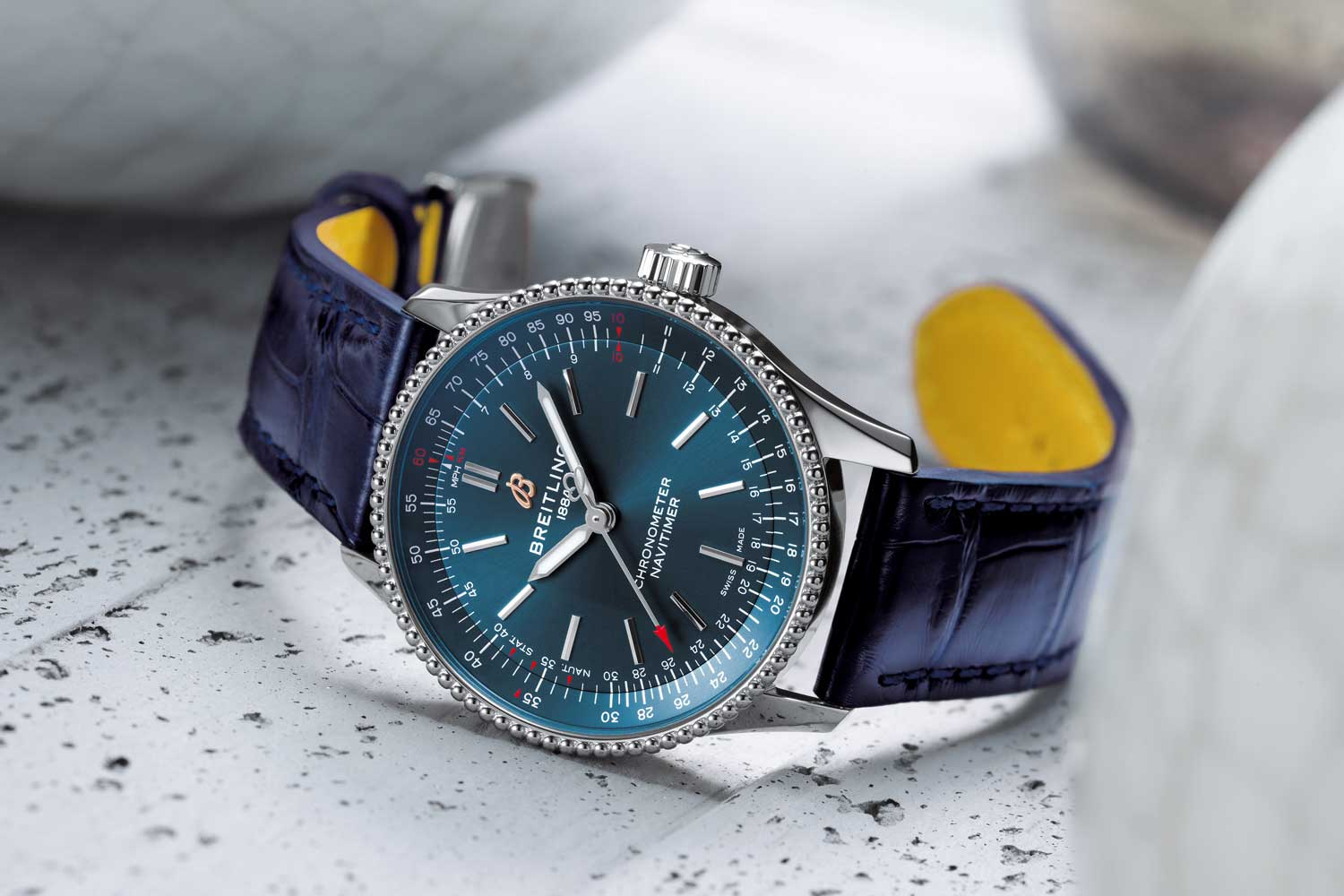 Navitimer Automatic 35 with a blue dial and a blue alligator leather strap