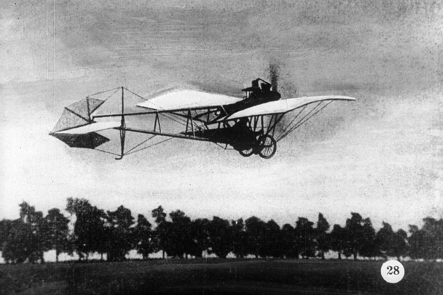 Alberto Santos-Dumont in his La Demoiselle plane.