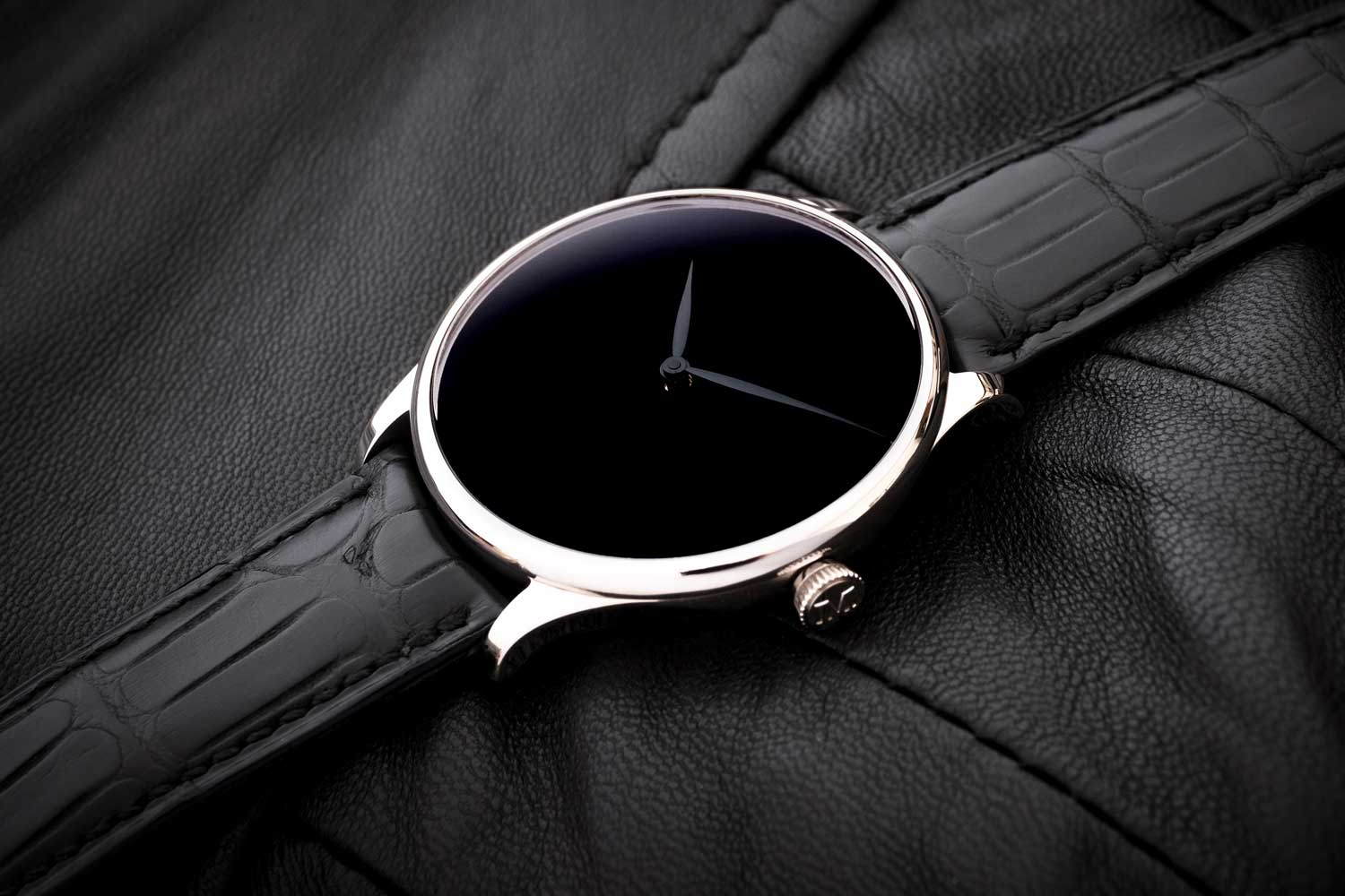 The absolute pitch black of the Vantablack dial shows against its other black watch components.