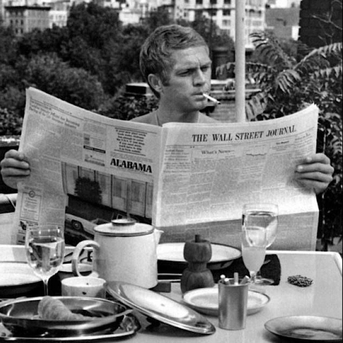 Steve McQueen in the 1968 film, The Thomas Crown Affair having breakfast alongside co-star Faye Dunaway