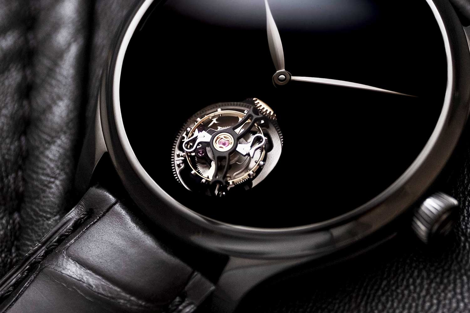 The tourbillon's polished components stand out against the Vantablack dial and PVD-coated bridges.