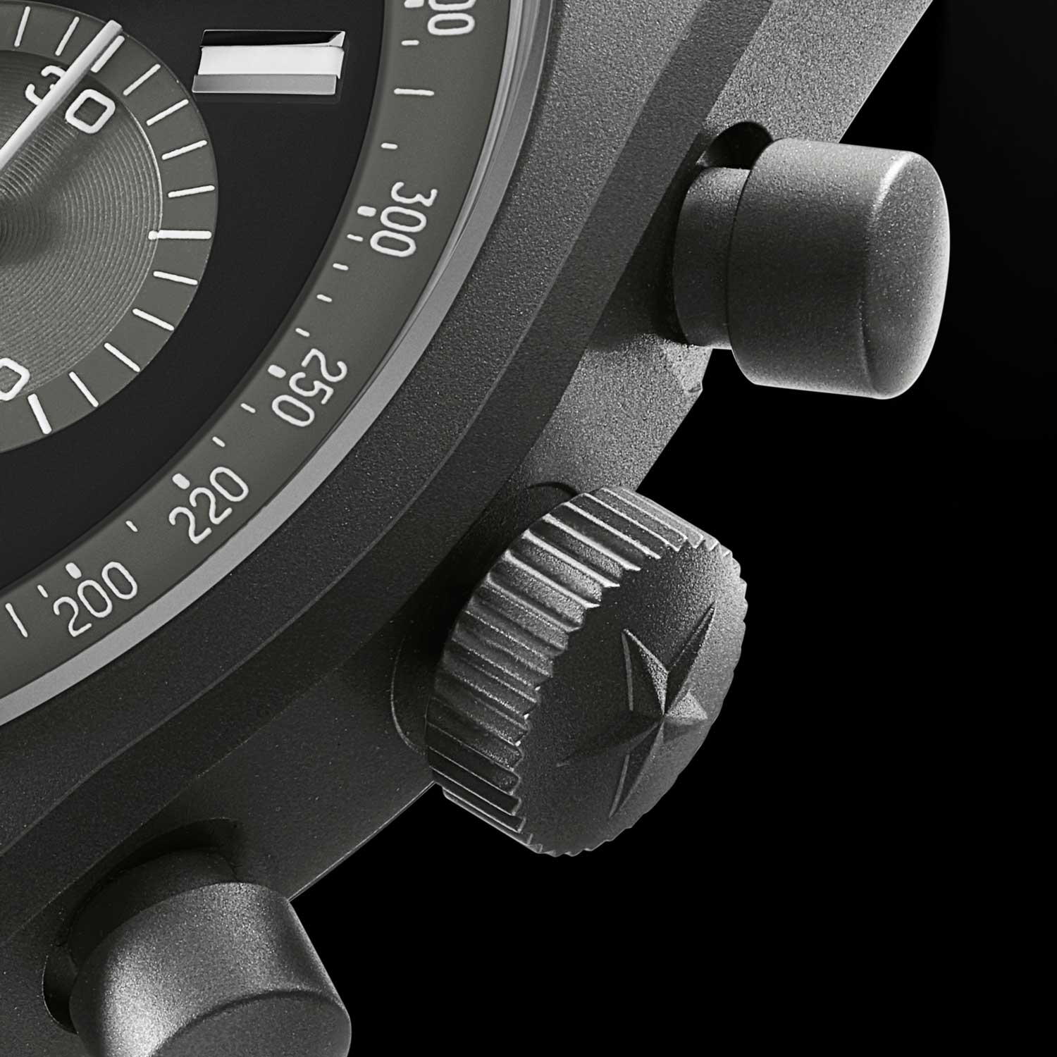 """Close up on case side of the of the Zenith Chronomaster Revival """"Shadow"""", showing off the microblasted titanium surface"""