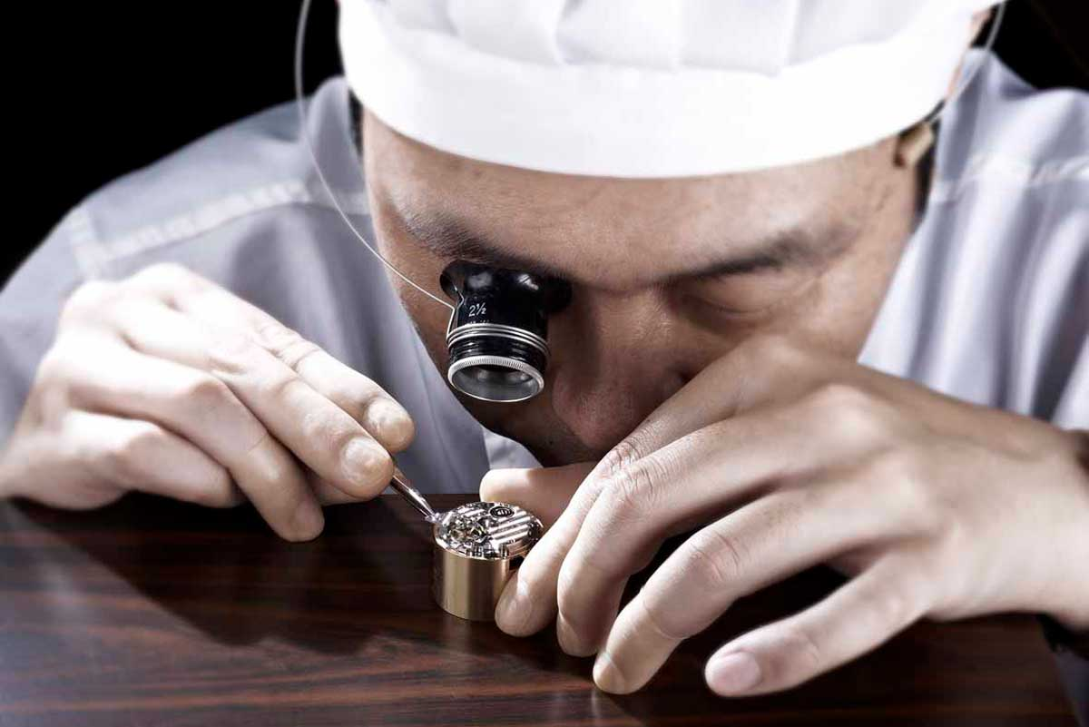 At the Grand Seiko Shizukuishi Watch Studio, a master watchmaker assembles a movement. - www.revolution.watch