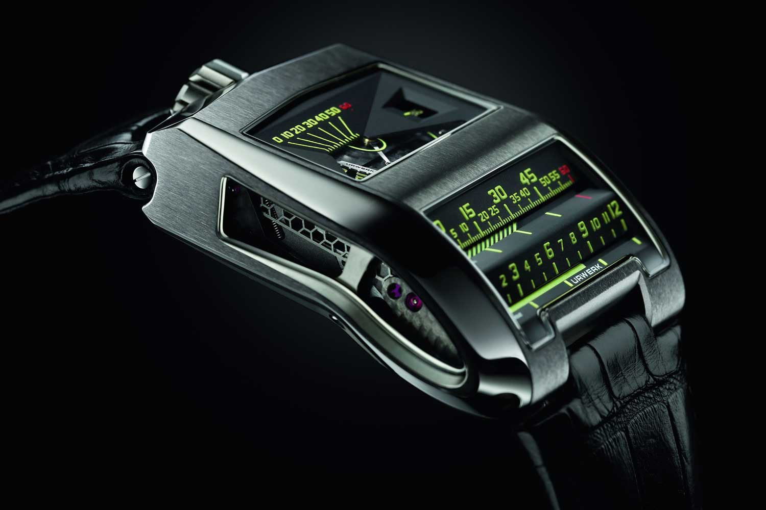 URWERK's UR-CC1, with a linear display of seconds, minutes and jumping hours, all coordinated by the use of a vertical triple cam.