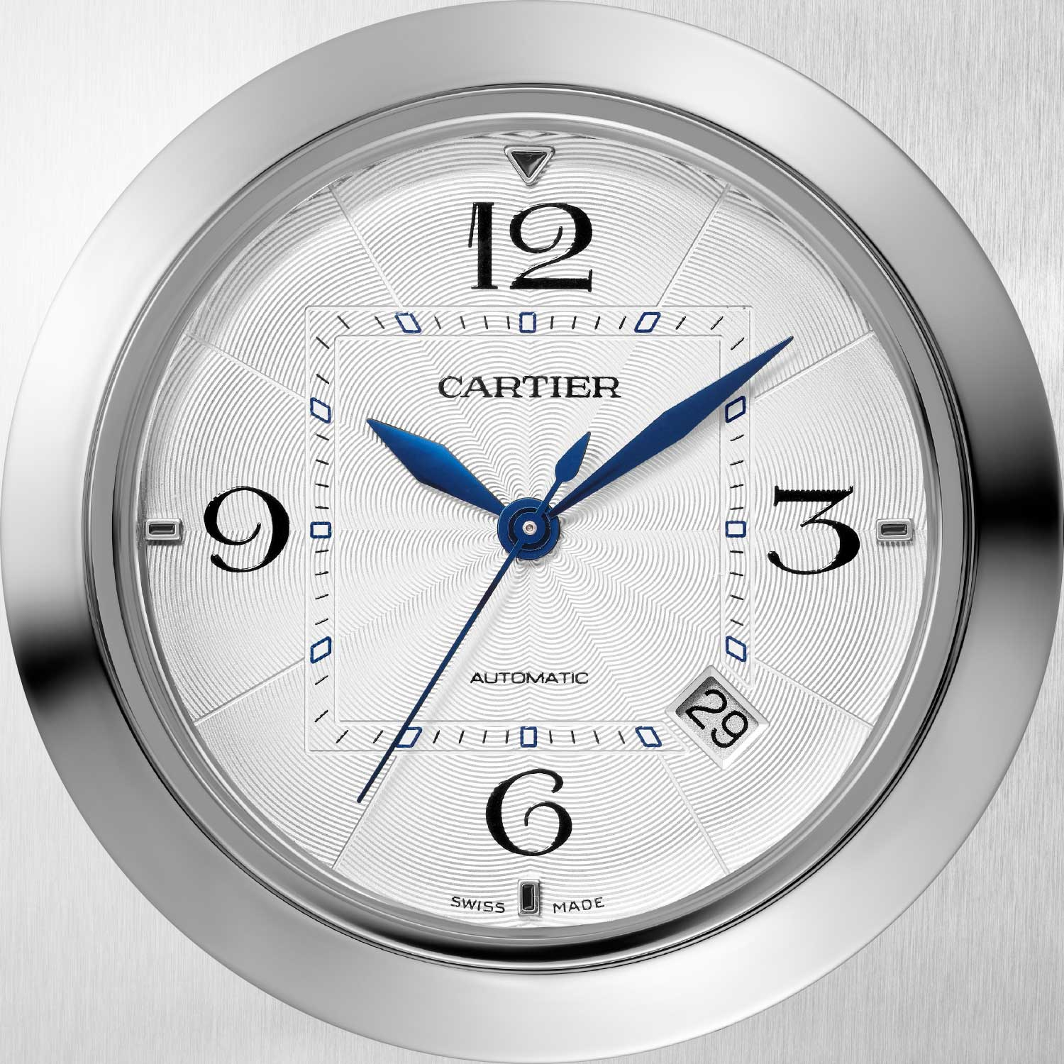 The new Pasha de Cartier watch features a clean but more intricate stamped dial