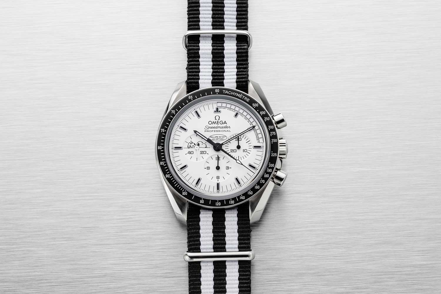 "Omega issued the Speedmaster ""Silver Snoopy"" on the 45th anniversary of the Apollo 13 mission with two meaningful inscriptions on the dial and a dramatic glow in the dark dial and bezel (Image © Revolution)"