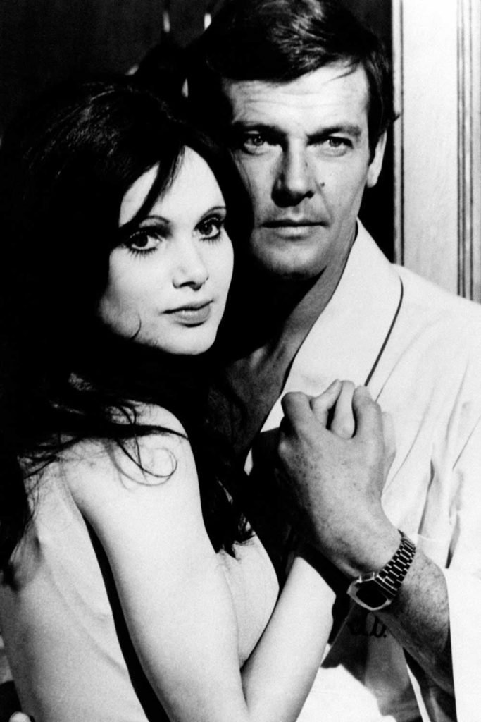 Roger Moore wearing a Pulsar P2, with Madeline Smith in Live and Let Die (1973) (Image: GettyImages)
