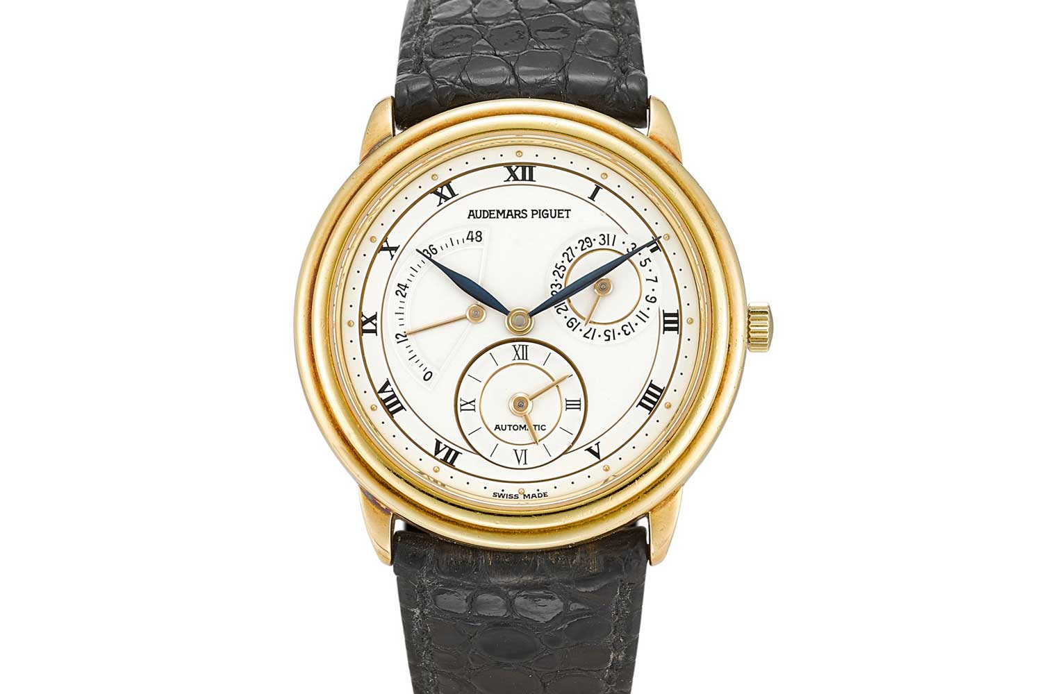 Audemars Piguet Dual Time reference 25685.002 - A yellow gold dual time zone wristwatch with date and power reserve indication from 1995