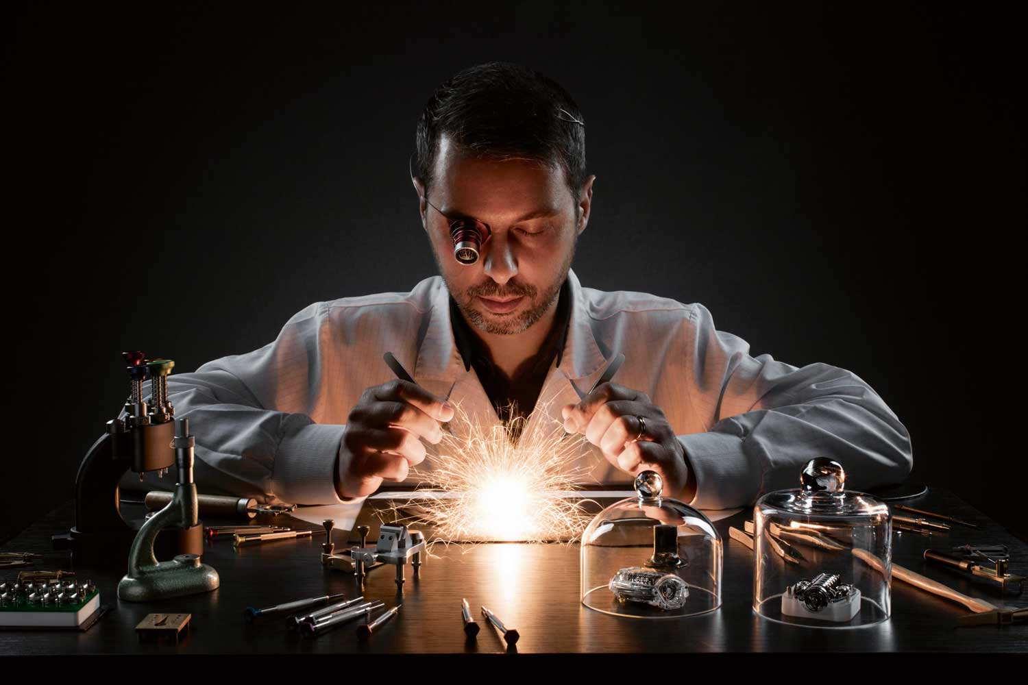 A visual released at the introduction of Magic Gold, featuring a watchmaker dynamically fusing technology with craft.