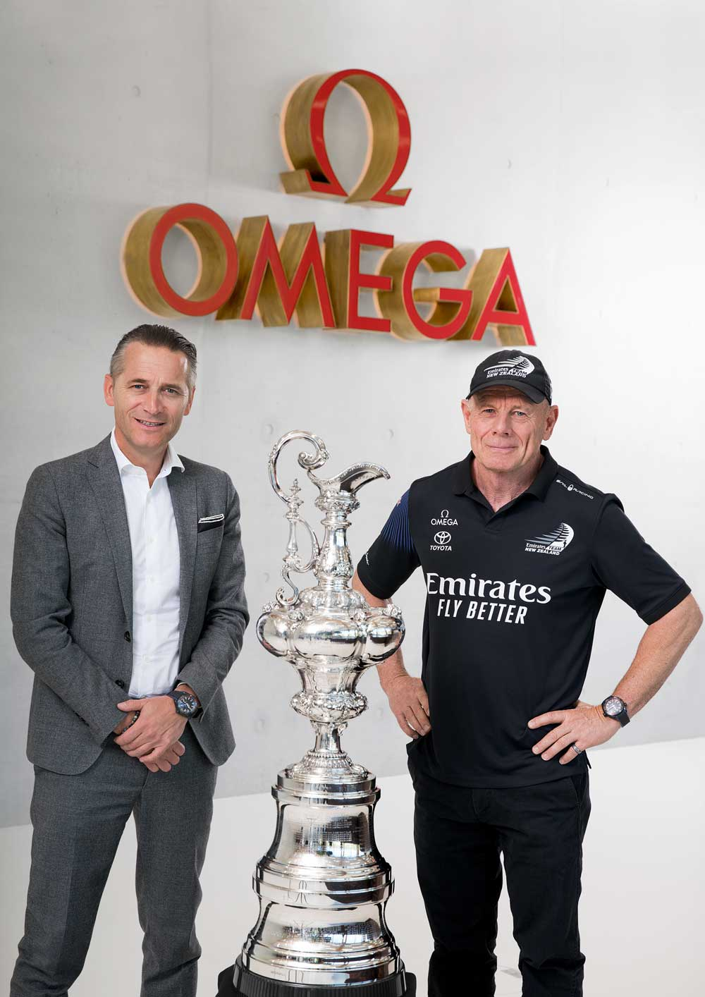 CEO of Omega, Raynald Aeschlimann poses with CEO of Emirates Team New Zealand, Grant Dalton with the America's Cup trophy.