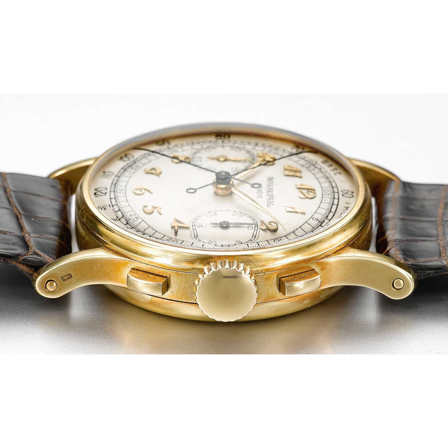 Case side of the 1946 Patek Philippe ref. 1436 yellow gold split second chronograph with Breguet numerals (Sothebys.com)
