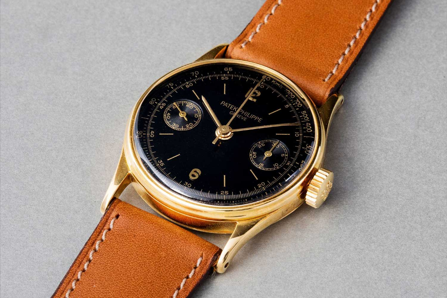 1929 Patek Philippe ref. 130 single-button chronograph wristwatch with black dial and tachometer scale (Image: phillipswatches.com)