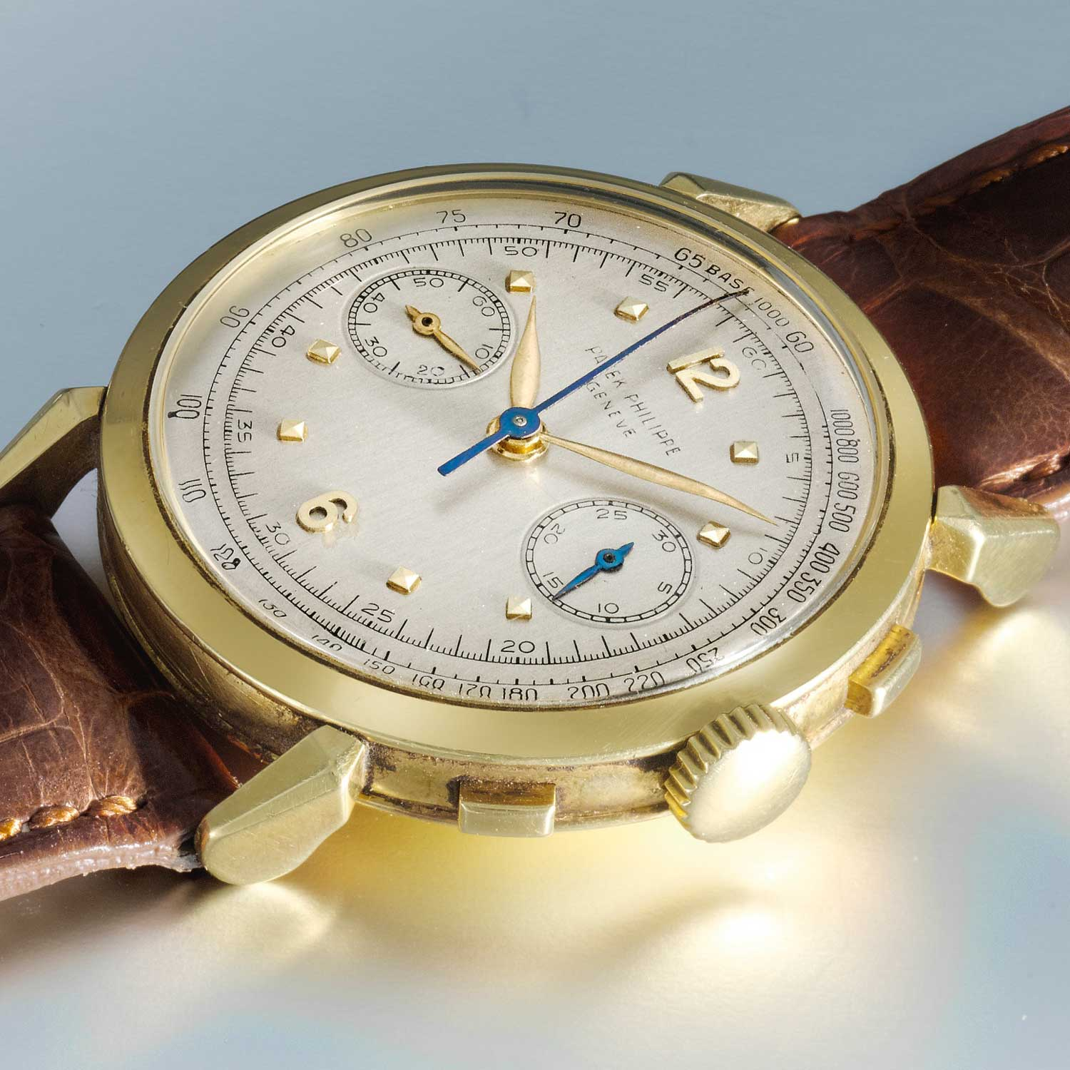 1956 Patek Philippe ref. 1579 gold chronograph with silvered dial, applied yellow gold Arabic numerals and square indexes (Image: Sothebys.com)