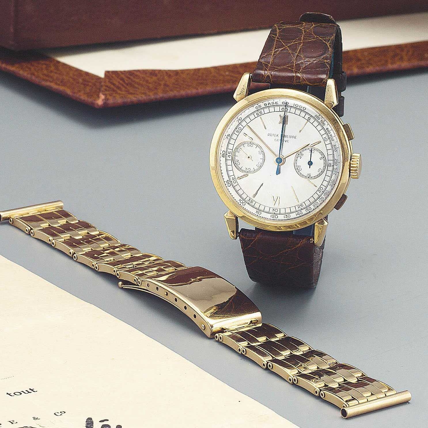 1949 Patek Philippe ref. 1579 gold chronograph with silvered dial, applied gold roman and baton numerals, supplised with with gold bracelet (Image: Sothebys.com)