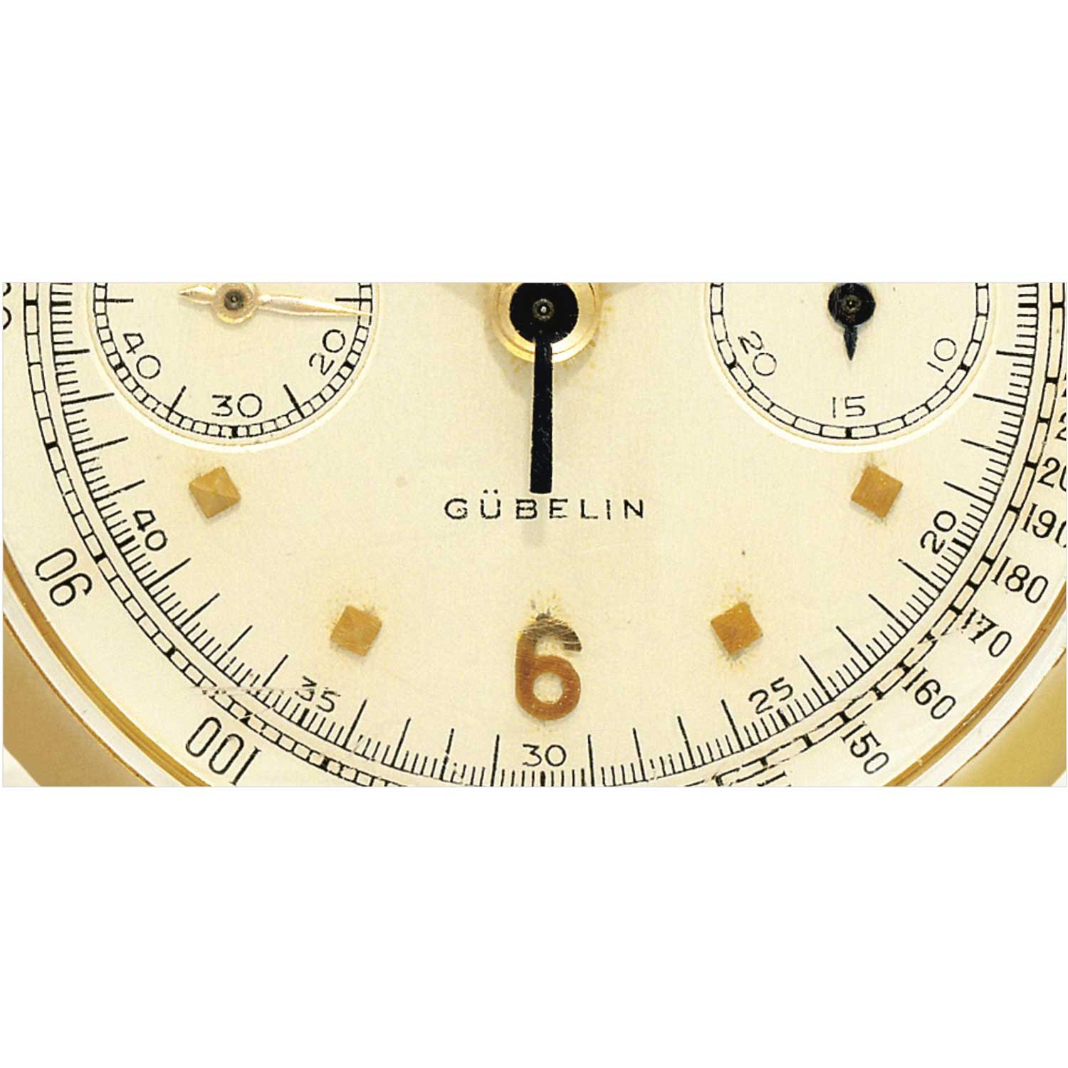 Gübelin stamp on the 1953 Patek Philippe ref. 1579 yellow gold chronograph with silvered dial, applied gold faceted square and Arabic numerals, retailed by Gübelin (Image: Sothebys.com)