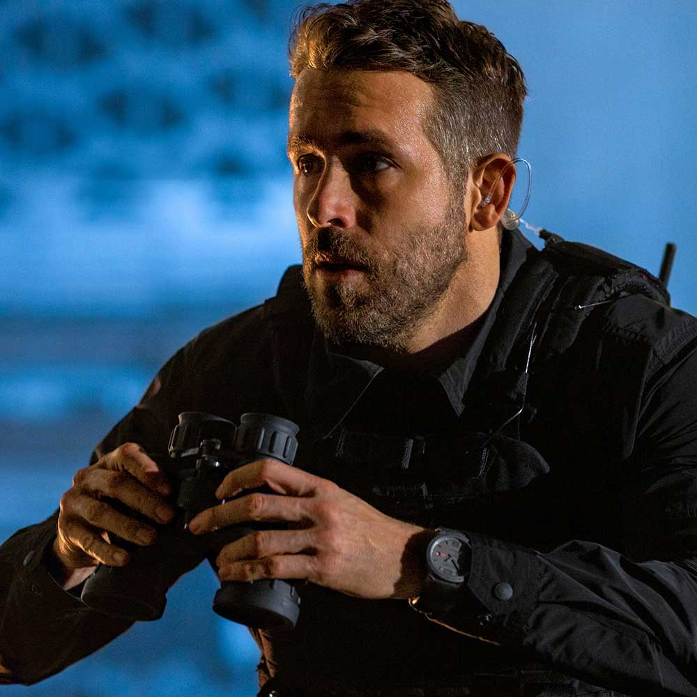 Actor Ryan Reynolds in the Netflix film, 6 Underground wearing the Mille Miglia GTS Power Control Grigrio Speciale prototype donated by Chopard for Revolution x The Rake Covid-19 Solidarity Auction