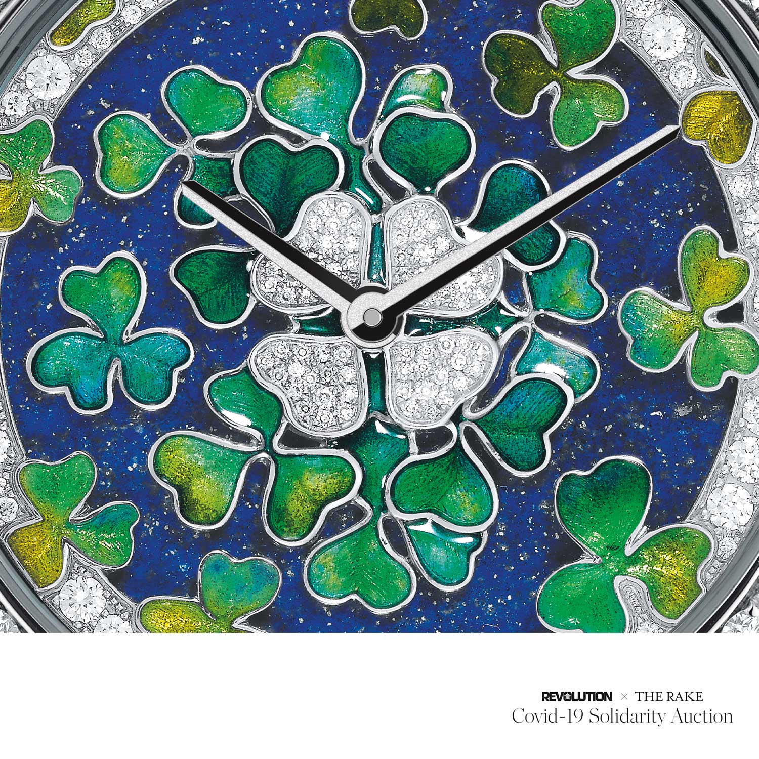 A close up on the dial of the Midnight Palais de la Chance Trèfles Décor created using gold sculpting, champlevé enamel, translucent enamel, Lapis Lazuli selection and marquetry and diamond setting using DEF/ VVS stones