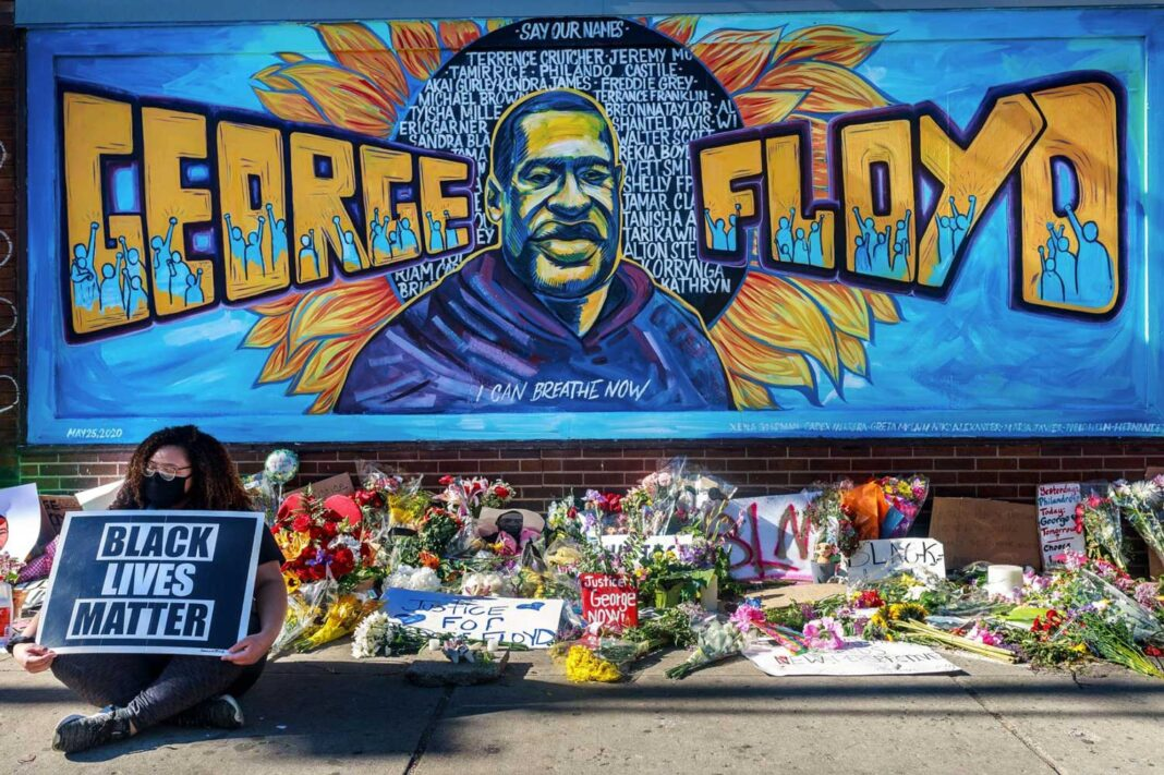 Flowers, signs, and balloons are left near a makeshift memorial to George Floyd near the spot where he died while in custody of the Minneapolis police on May 25. PHOTOGRAPH BY KEREM YUCEL, AFP/GETTY (Reposted from nationalgeographic.com)