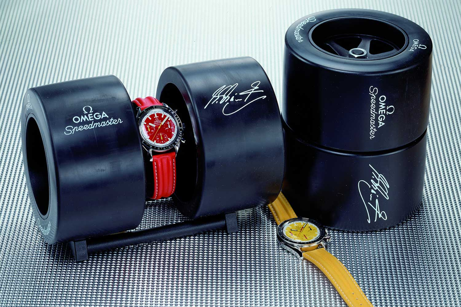 The 1996 Racing Speedmaster Reduced Launched by Michael Schumacher seen here with the special presentation cases (Image: omegawatches.com)