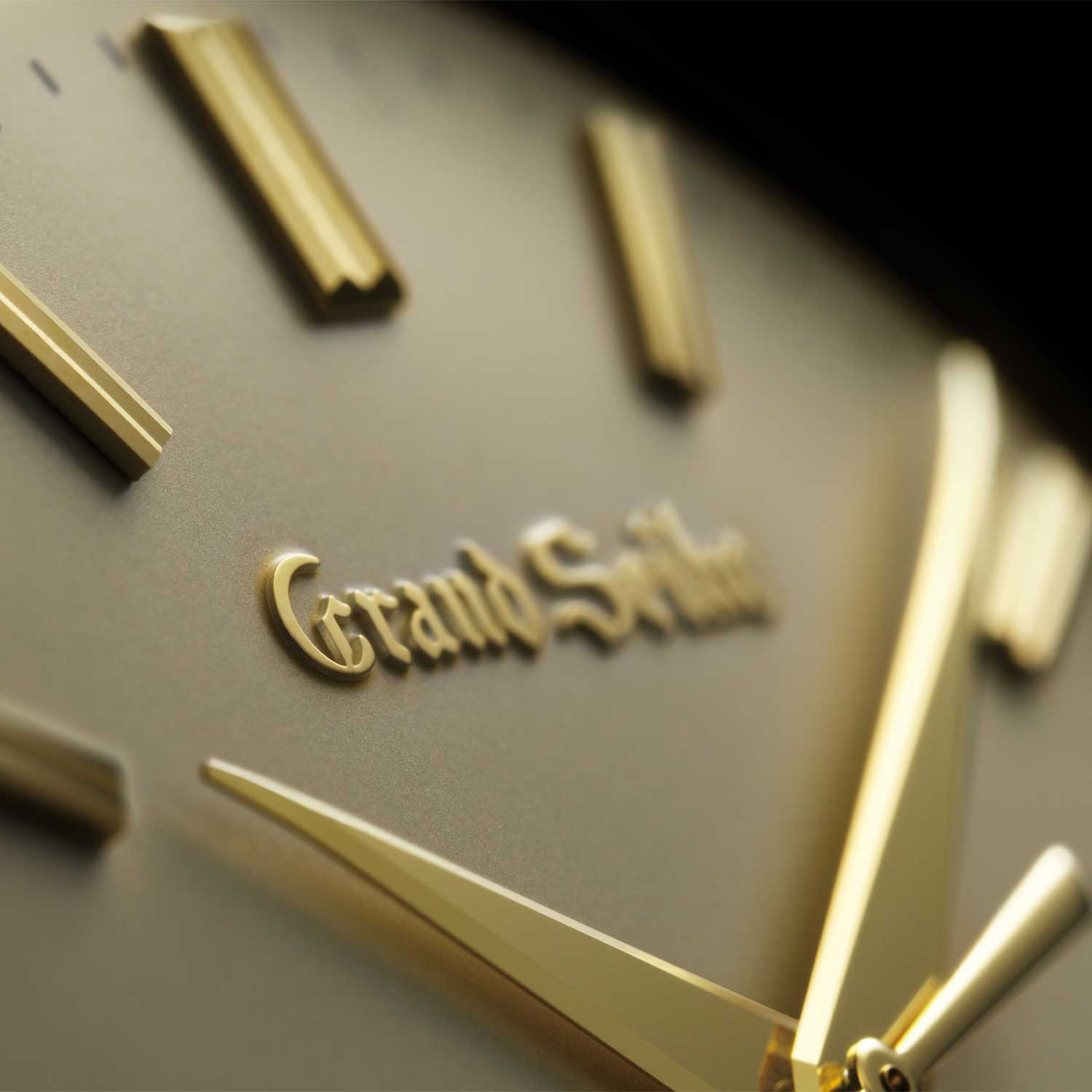 A close up on the dial of one of three of the re-creations of the first Grand Seiko in 18k yellow gold (SBGW258)