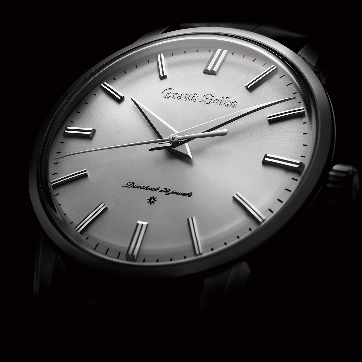 "A close up on the dial of one of three of the re-creations of the first Grand Seiko in platinum 950 (SBGW257) with the engraved ""GRAND SEIKO"" logo"