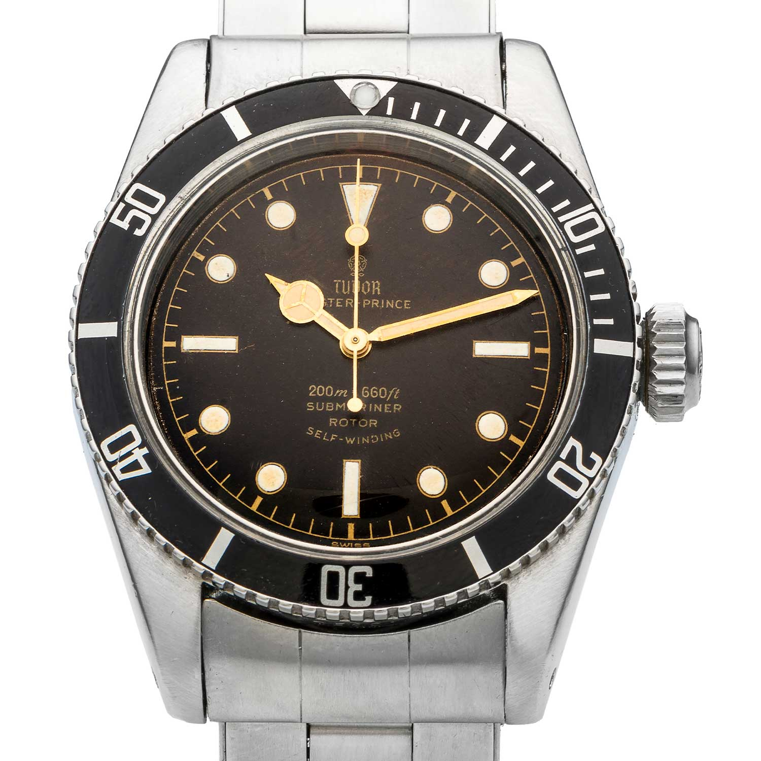 "A close up on the dial of the 1958 ""Big Crown"" Tudor Oyster Prince Submariner ref. 7924; note the gilt ""meters first"" 200m depth rating (Image: antiquorum.swiss)"