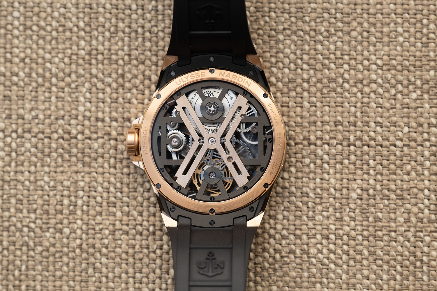 Caseback view of the Ulysse Nardin Rose Gold Blast (ref. T-1725-400/02) on a velvet strap (©Revolution)