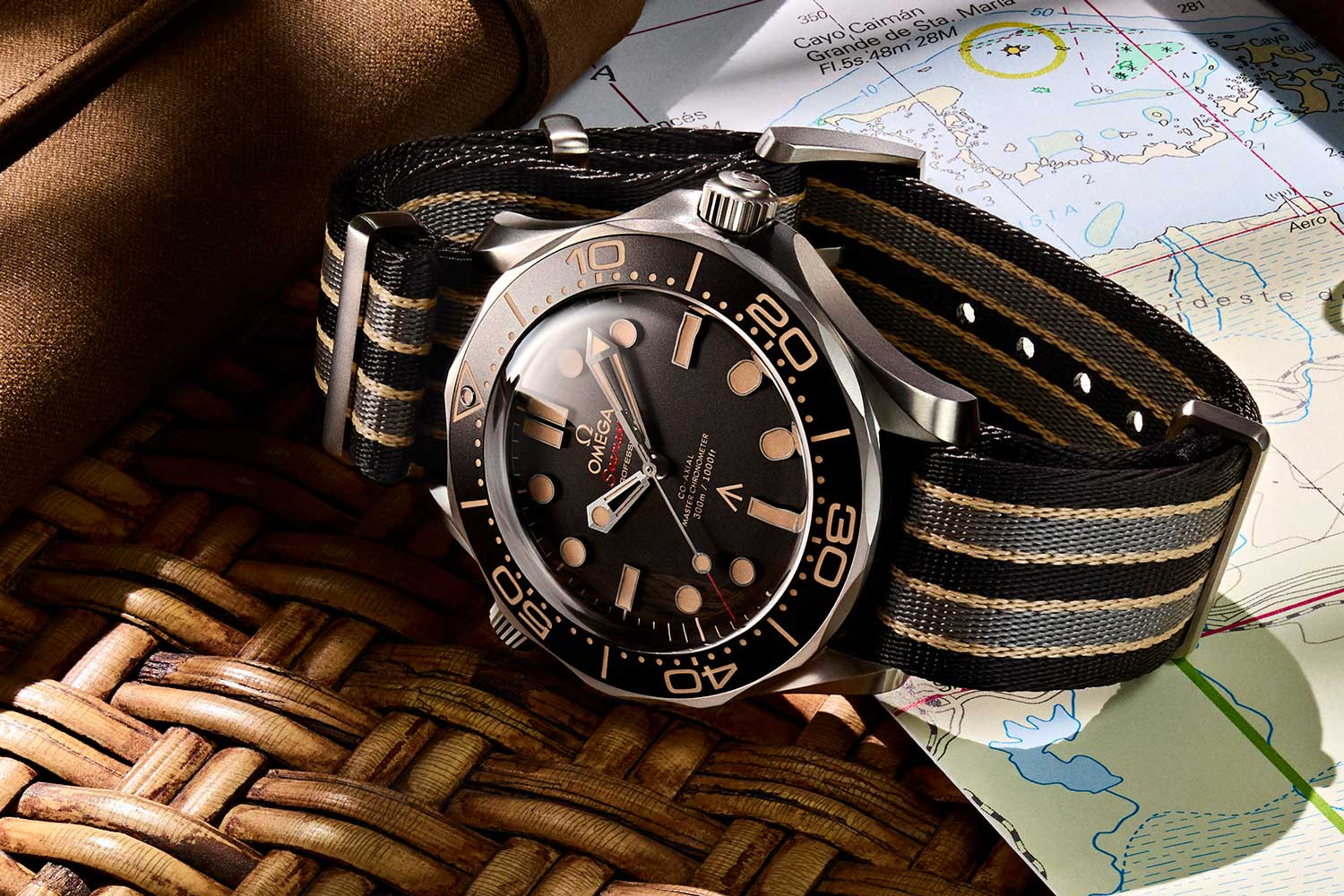 The brand new Seamaster Diver 300M features the Broad Arrow and is housed in grade 2 titanium with a grade 2 titanium mesh Milanese-style flat bracelet, a first for the series and designed with input from Daniel Craig himself