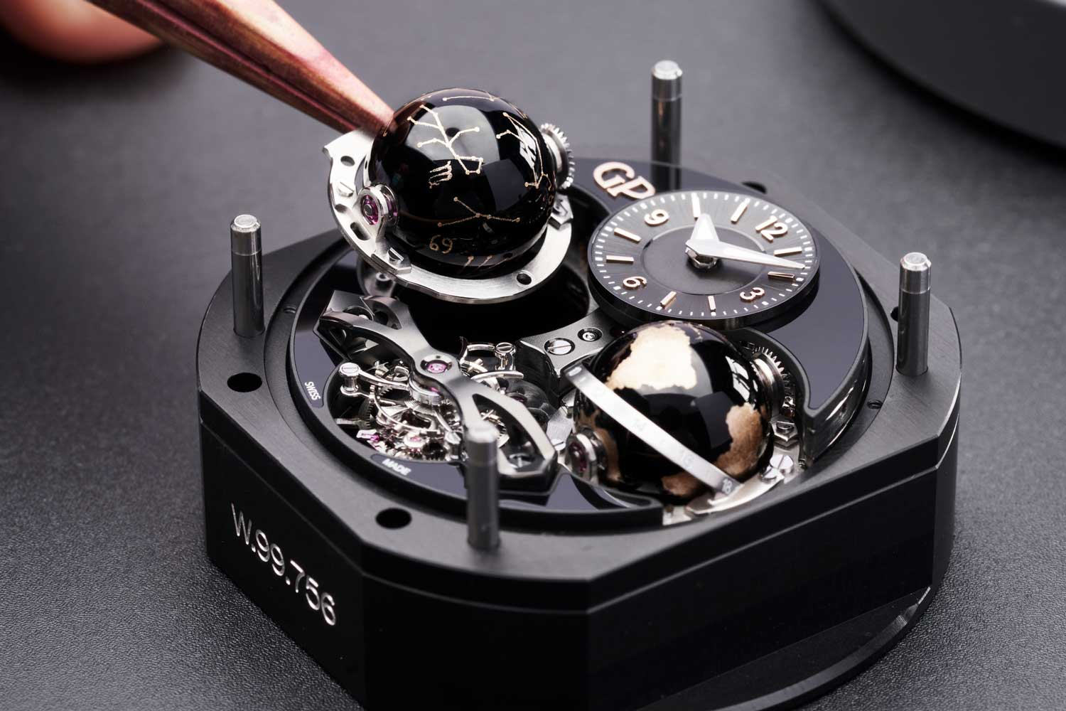 The watch uses the bélières system to set its mechanisms as seen on the back of the case.