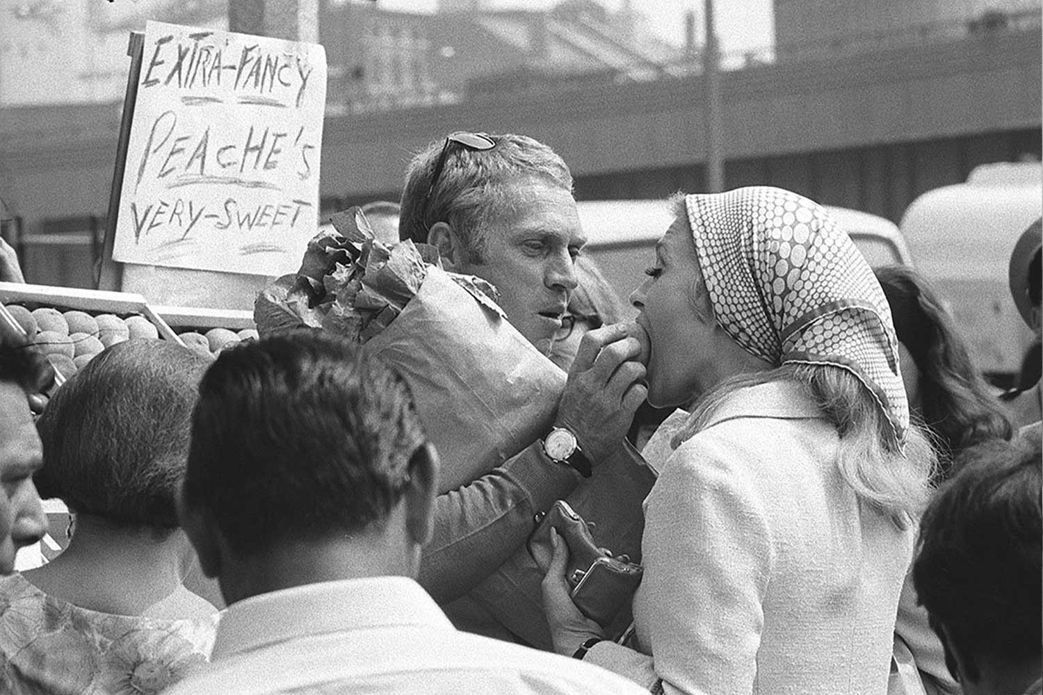 Steve McQueen (1930 - 1980) feeds a peach to actress Faye Dunaway in the street market during filming of 'The Thomas Crown Affair' — on his wrist the Memovox that appears on screen on his wrist (directed by Norman Jewison), Boston, Massachusetts, August 11, 1967. (Photo by Jerry Schatzberg/Getty Images)