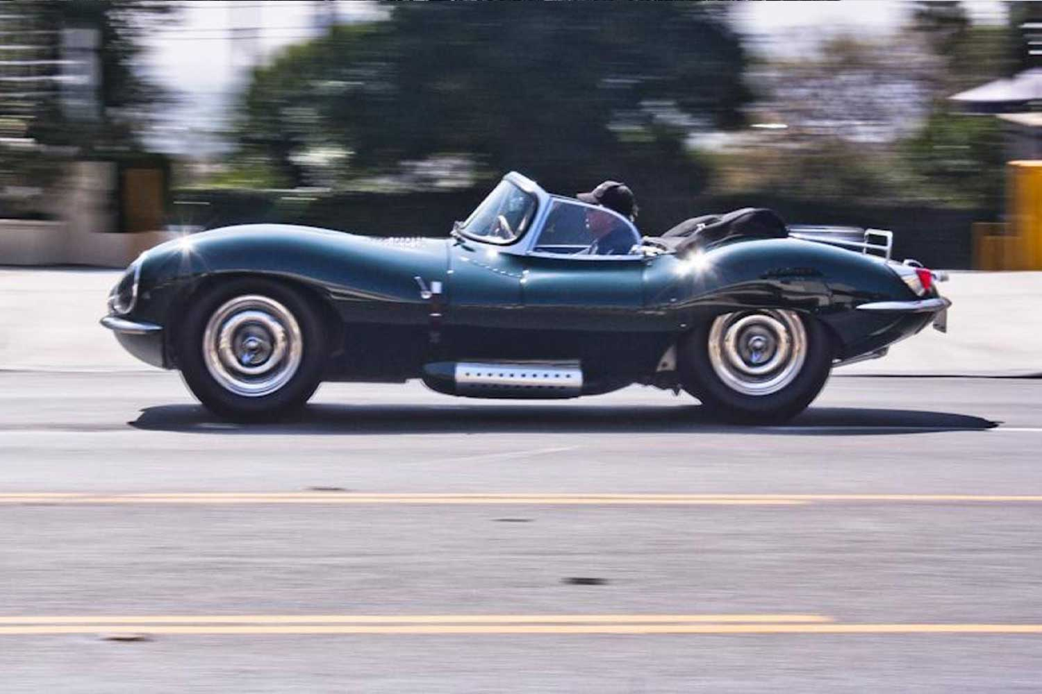 Steve McQueen speeding through Los Angeles in his 1956 Jaguar XKSS, serial no. 713, one of 16 made. (Image: Blake Z. Rong / autoweek.com)