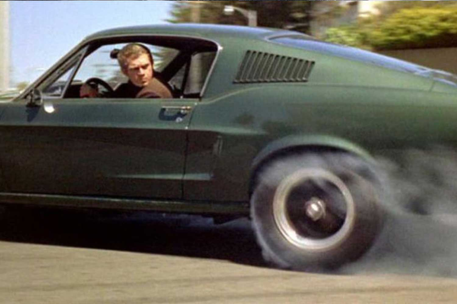 Steve and the McQueen Bullitt Mustang GT 390 Fastback, which made for one of the most memorable car chase scenes in all of Hollywood (Warner Bros.)
