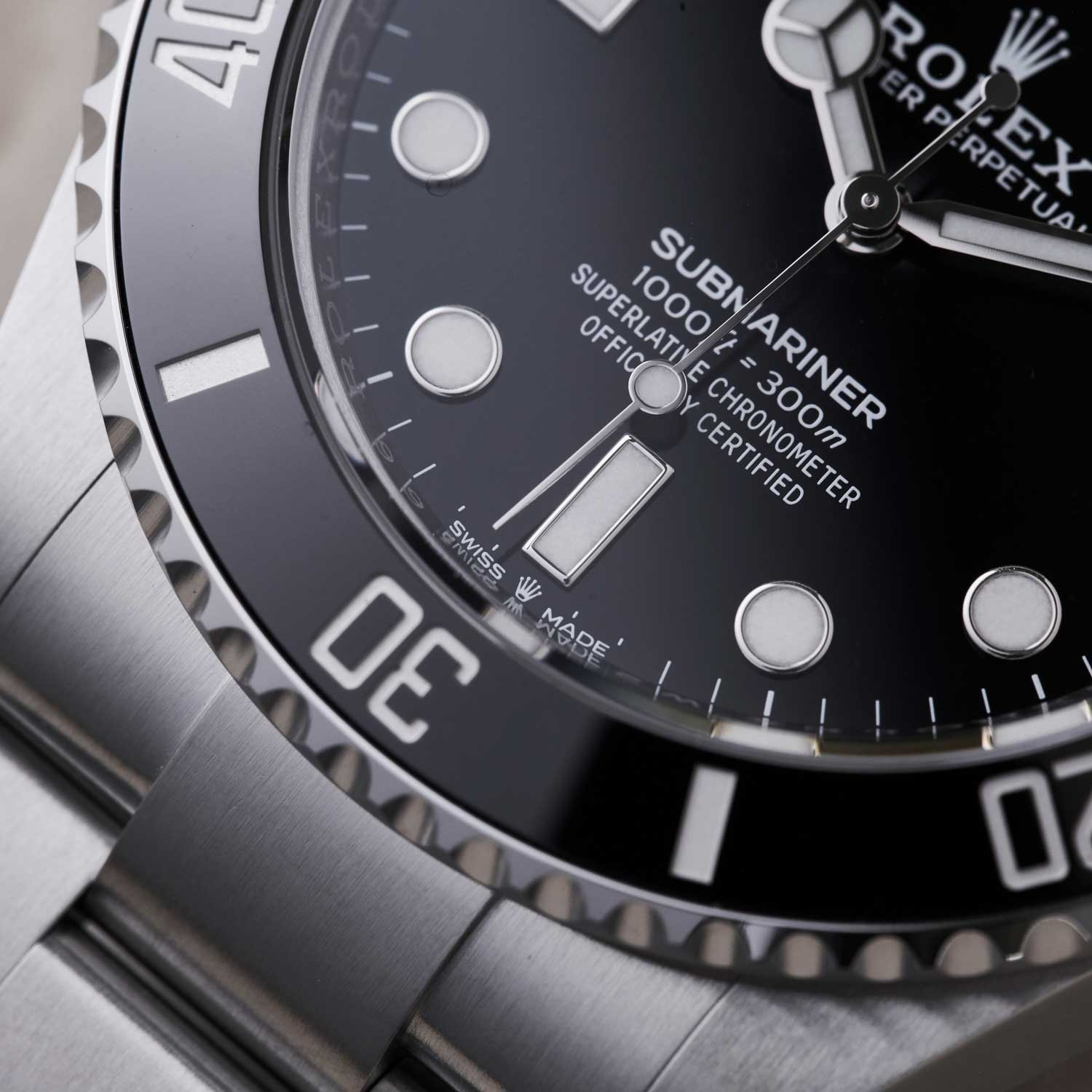 """Since 2018, Rolex has demarcated all of their Superlative Chronometer rated watches with a new coronet printed between the words """"Swiss Made"""" at 6 o'clock; this now also appears on the dial of the 2020 family of Submariner watches (©Revolution)"""