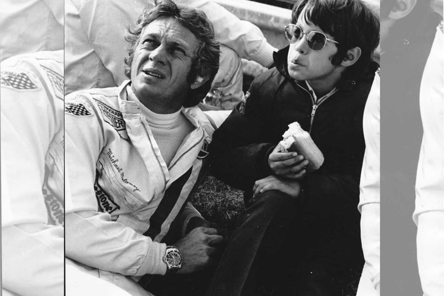 Father and son: McQueen, with his son, Chad, relaxes on the set of the 1971 movie 'Le Mans.' Though he wore a Heuer Monaco in the movie, he sports a Rolex Submariner here. (Photo by Anwar Hussein/Getty Images / Forbes.com)
