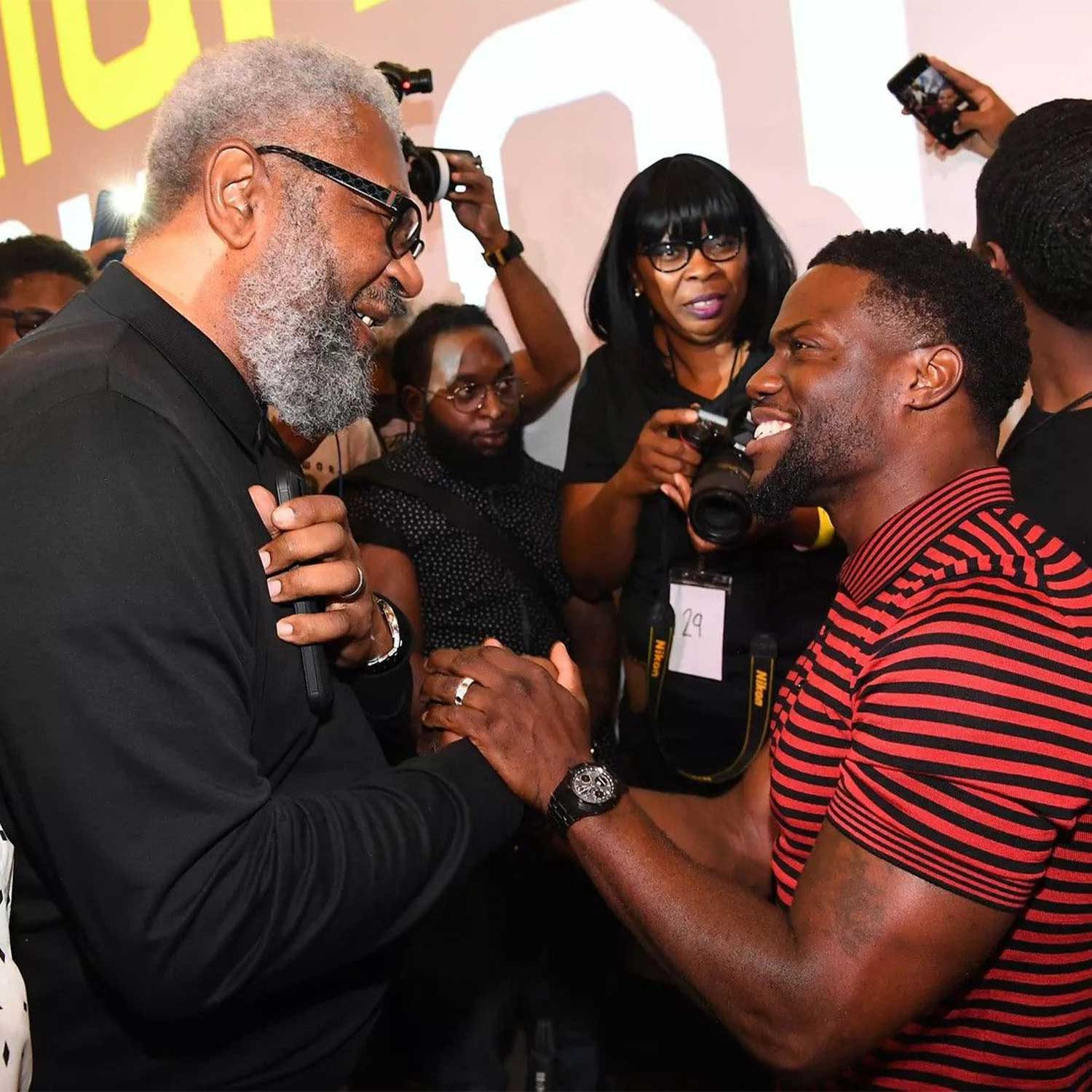 "ATLANTA, GA - SEPTEMBER 11: Kevin Hart (R) greeted by Nathaniel Norment (L) during Morehouse College REAL TALK with ""Night School"" actor Kevin Hart & producer Will Packer at Morehouse College on September 11, 2018 in Atlanta, Georgia. The watch on Hart's wrist is the Royal Oak Perpetual Calendar Ceramic Ref. 26579CE (Photo by Paras Griffin/Getty Images for Universal Pictures)"