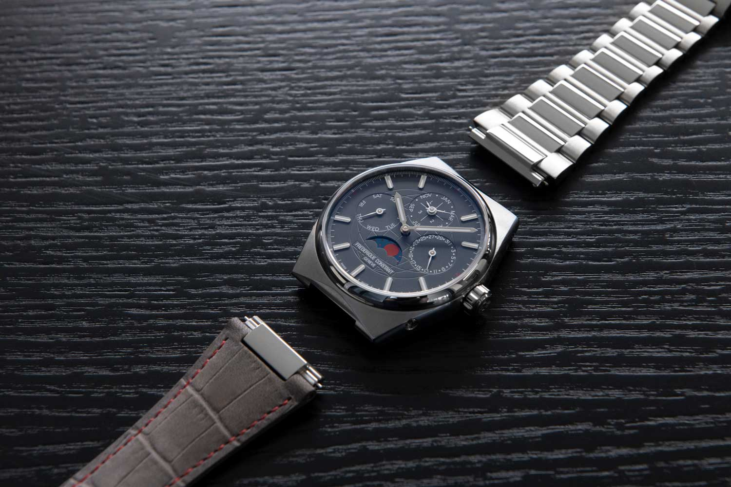 The perpetual calendar model comes with a blood-red moon, and a choice of stainless steel bracelet or a grey leather strap with red stitching.