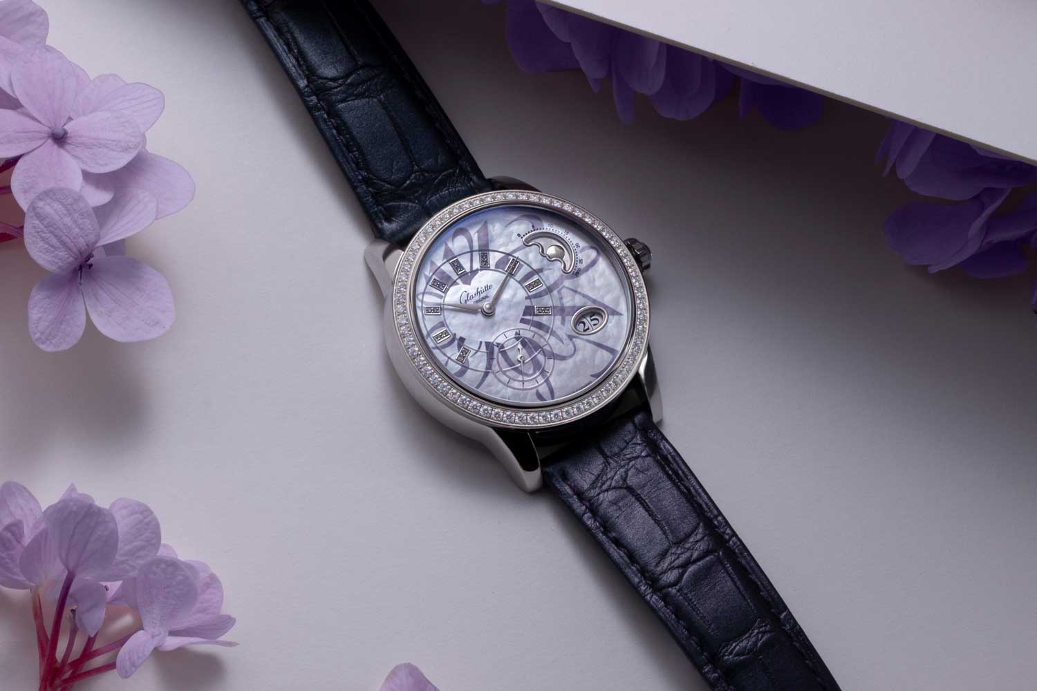 The ladies' automatic PanoMatic Luna limited-edition features small seconds, second stop, Panorama date, off-center hour and minutes, and a charming moon phase with tiny hearts standing in for stars.(©Revolution)