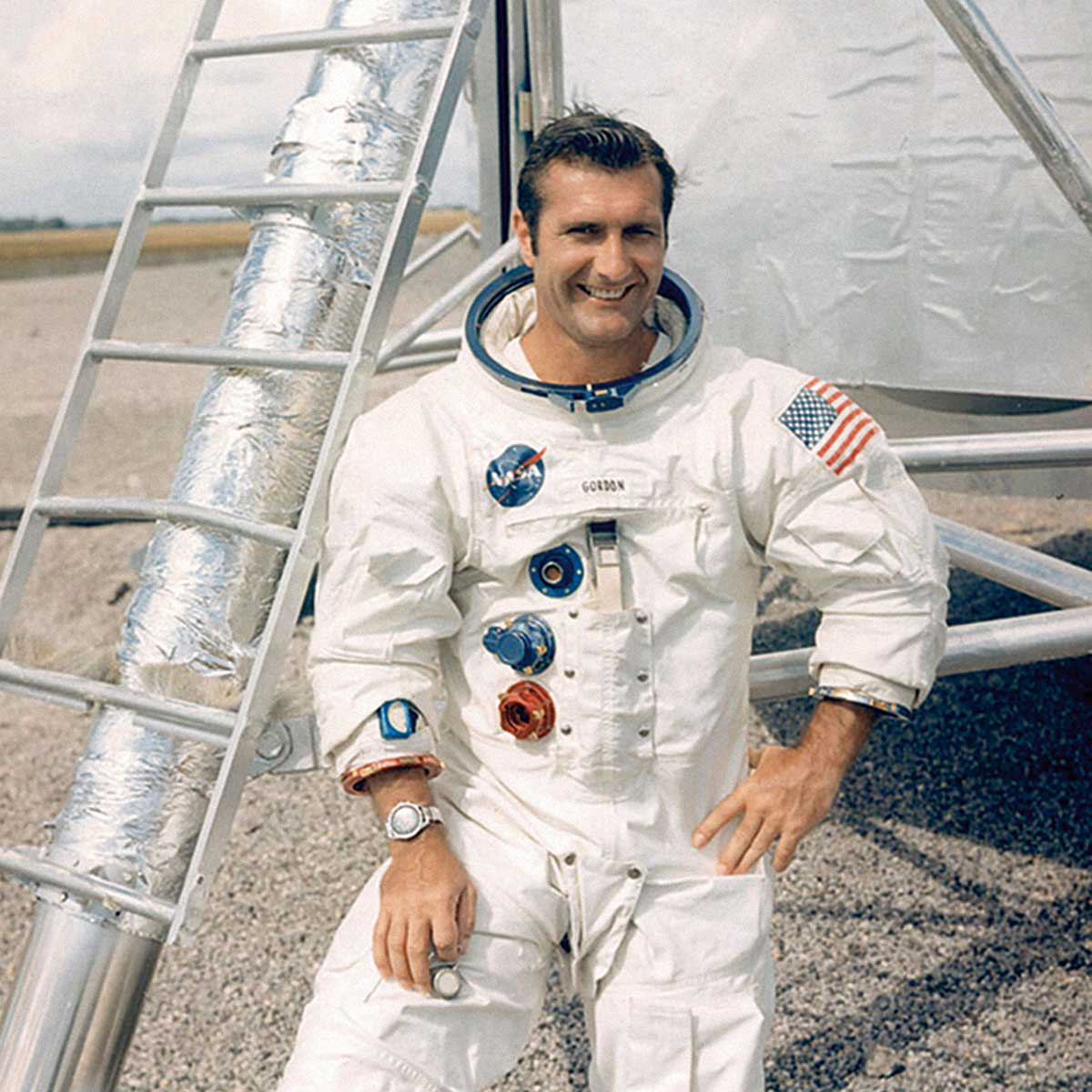 Gordon poses in front of a lunar module mock-up at Cape Canaveral (formerly Cape Kennedy) with his Speedy on a JB Champion strap with curved end pieces.