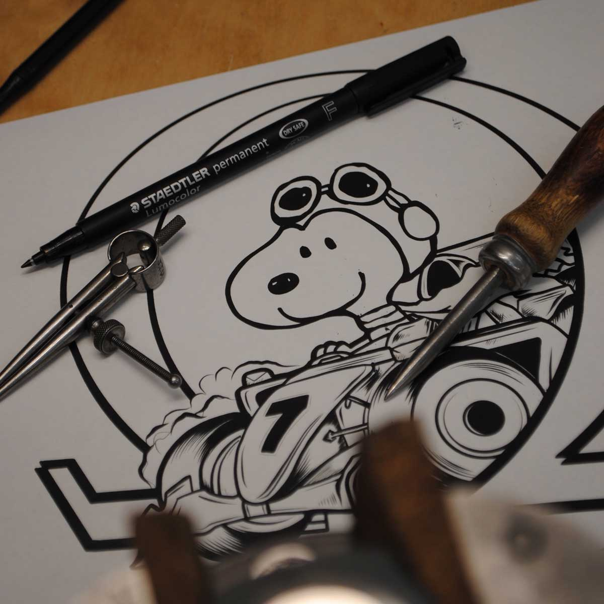 The design for the engraving features Snoopy in an F1 as Michael Schumacher