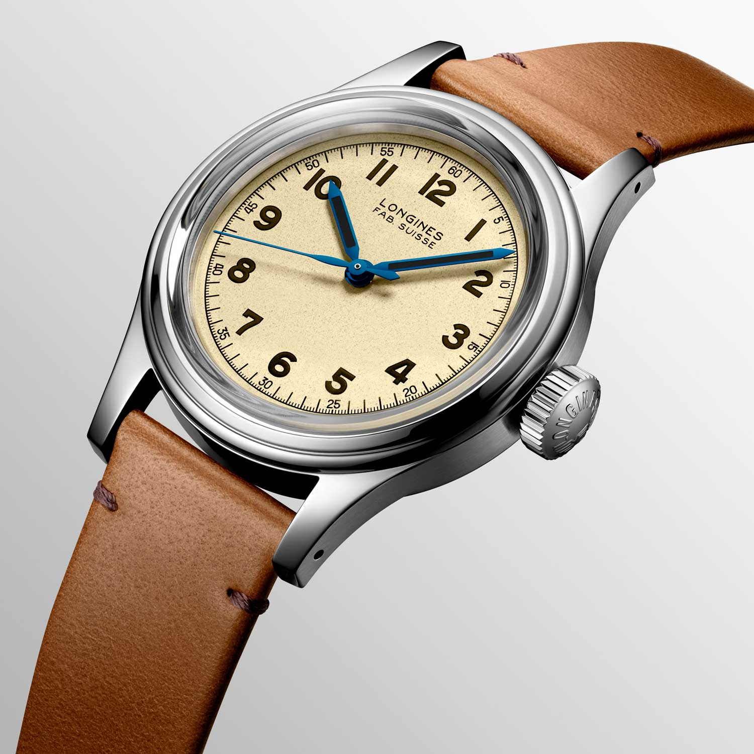 The watch has a lightly grained dial with blued steel hands coated with brown Superluminova
